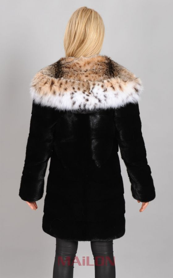 Black Mink parka with Lynx hood and pelts across