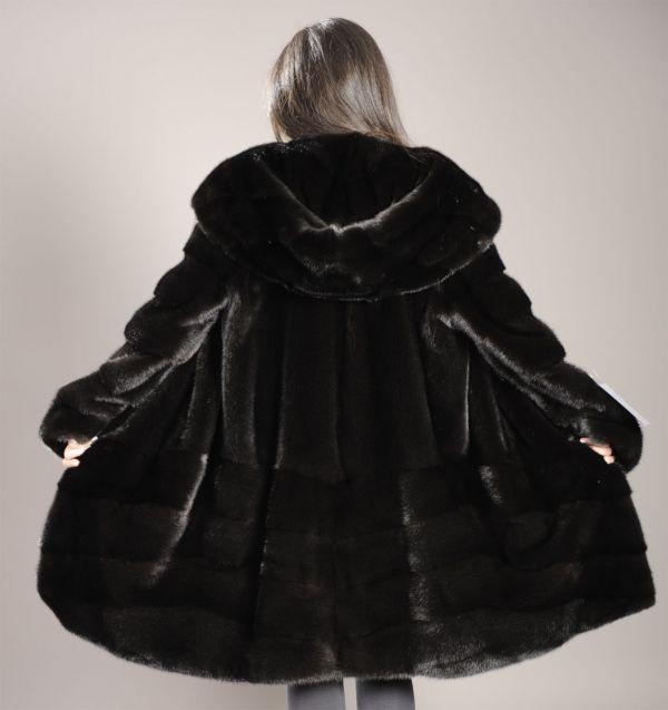 Black mink coat with hood & partly pelts across